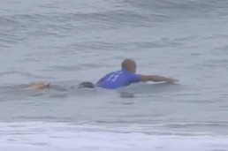 Kelly Slater surf paddling